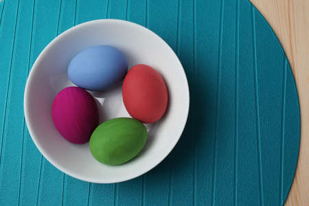 colored dye: Easter eggs in the plate. Stock Photo