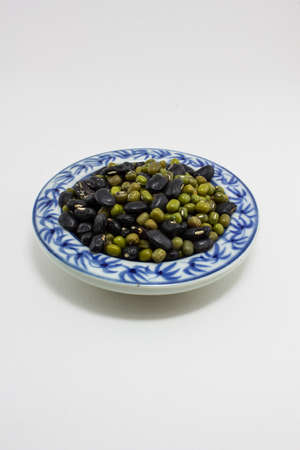 Close up mung bean in ceramic dish isolated on white - with path photo