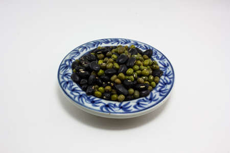 Close up mung bean in ceramic dish isolated on white - with  photo
