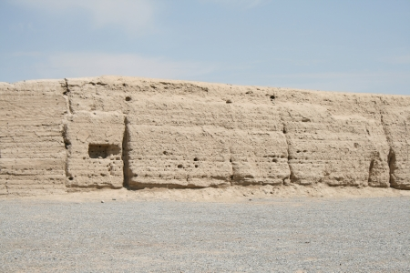 the Western end ancient great wall of China, Gansu province  The oldest part of the great wall in Han dynasty made of straw with the rammed earth construction technique  located in Gansu province at the Taklamagan desert the area of Gobi desert and the bo photo