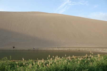 Mingsashan, the crescent moon lake, sand dune oasis at Dunhuang, Gansu province China Stock Photo
