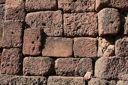 laterite: red laterite stone texture background