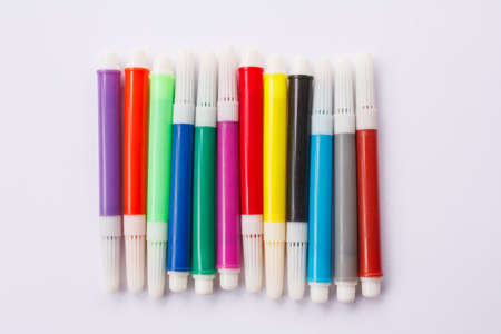 hued: Group colored pens on a white background Stock Photo