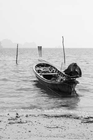folkways: Boat on sea beaches by rural folkways Stock Photo
