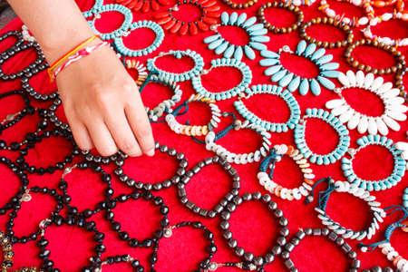 Panel bracelet on a red background photo