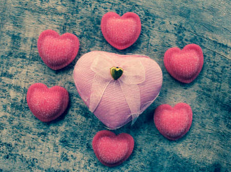 Valentines Day background with hearts and wooden floors photo