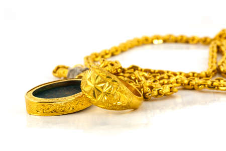 Jewelry gold on a white background photo