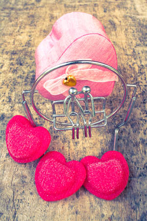heart shaped stuff: Valentines Day background with hearts and wooden floors