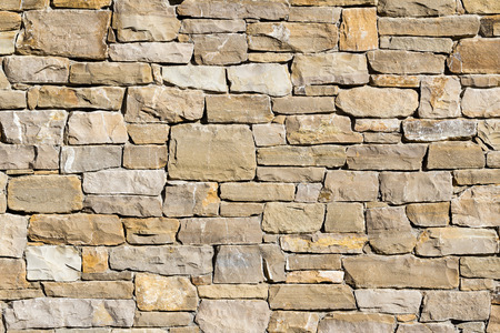 Fond de mur de pierre fait avec des blocs