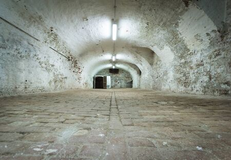 Basement of old fortress with vaulted brick ceiling - ancient dungeons