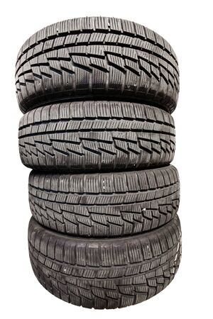 winter tires: Four used winter tires isolated on white background