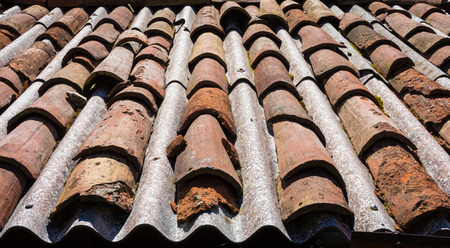 Roof in dangerous asbestos and old tiles