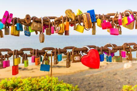 rusty chain: Padlocks of love on rusty chain seaview Stock Photo