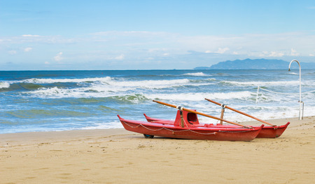 rescue boat on the beach - rough sea Stock Photo