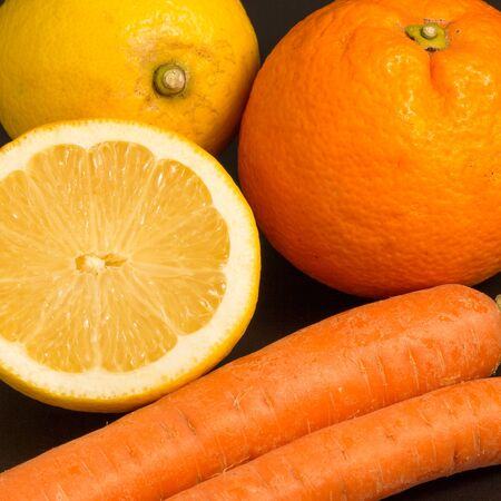 carot: Natural composition of orangel lemon and carot Stock Photo