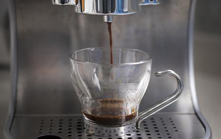 Espresso coffee preparation in a glass cup