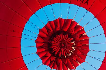 red balloon: Top of a Red Balloon under a blue sky