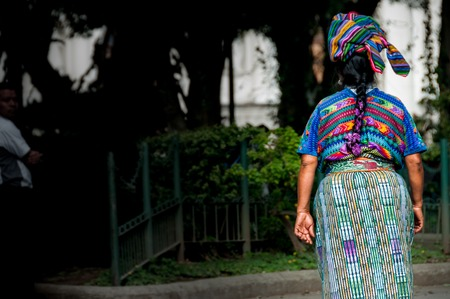 An Indigene Woman walking thorugh Antigua in Guatemala
