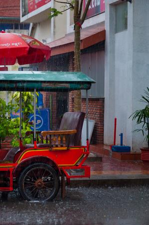 mototaxi: Tuktuk during rain monsoon in Kampot Cambodia