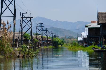 pile dwelling: Village with electricity at Inle Lake Burma Myanmar Stock Photo