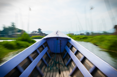 lila: Motion Blurred Lila boat driving on Inle Lake Burma Myanmar