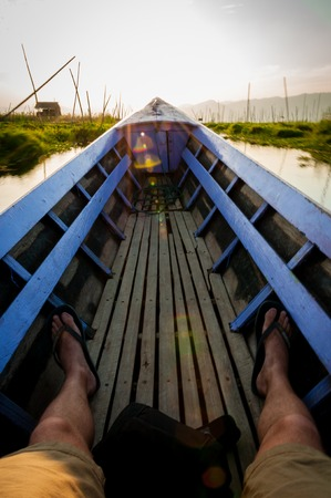 lila: POV sitting on a lila boat Inle Lake Burma Myanmar Stock Photo