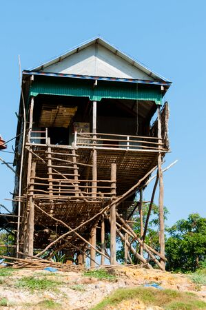 stilted: House on stilts in Cambodia close to Siem Reap Stock Photo