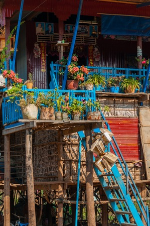 stilts: Sweet blue wooden house on stilts with flowers