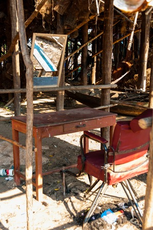 stilted: Chair and a mirror a hairdresser in Cambodia