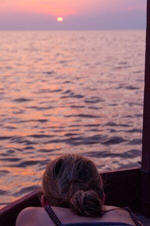 tonle sap: Girl watching sunset at tonle sap Cambodia