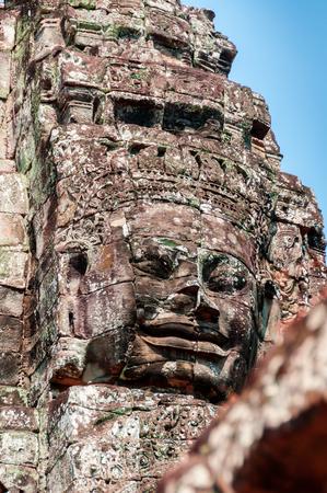 bayon: Head encarved in stone Bayon temple Angkor Wat Cambodia Stock Photo