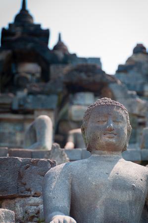 A smiling brahman sculpture of the Indonesian Temple, Borobudur