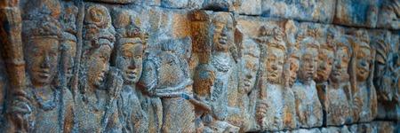 shul: Brahman Buddha  stone Carvings at Borobudur temple on the bricks in Indonesia