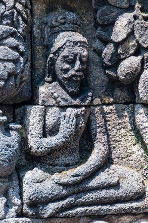 shul: Medidating and sitting Stone carving hindu god at Borobudur Stock Photo