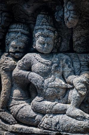 Medidating and sitting Stone carving hindu god at Borobudur Stock Photo