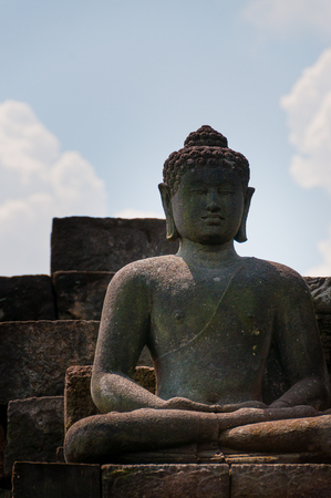 A smiling brahman sculpture of the Indonesian Temple