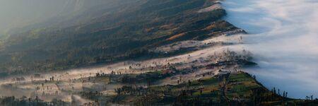 murk: The misty fog of volcano Bromo entering slowly the field Stock Photo