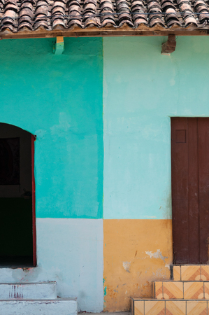 view of a wooden doorway: Two doors with colorful walls in Granada, Nicaragua, Central america