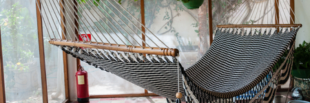 chillout: Big huge Hammock in black and white hanging inside a patio in colonial house in Granada Nicaragua Stock Photo