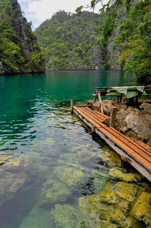 clear path: Very Clean and Clear lagoon lake Water next to a wooden path near Coron, Palawan, Philippines