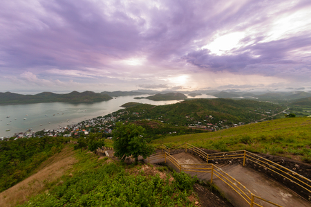 coron: Long Staircase leading down from the mountain in front of sky with purple clouds skyline, Coron, Palawan, Philippines