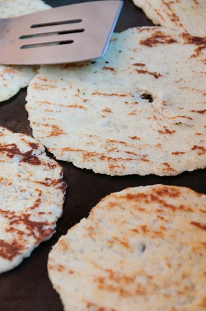stovetop: own beige Tortillas on stovetop Being Cooked on the Pan in the streets of Matagalpa in Nicaragua Stock Photo