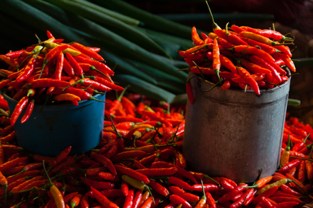 toraja: Red Chillies in bucket and laying around at local market in Tana Toraja, Sulawesi Indonesia