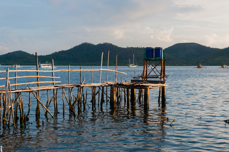 coron: Small wood jetty in front of ocean and island in Coron, Philippines Stock Photo
