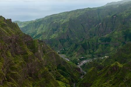 Steep green valley high above in the mountain of cape verde island close to africa Stock Photo