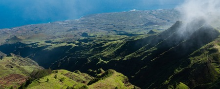 Steep green valley viewpoint leading to blue ocean coast of cape verde island off the coast of africa
