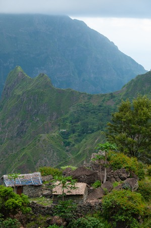 Simple rural stone house with tree  on top of green mountain in Cape verde islandoff the coast of senegal, africa Stock Photo