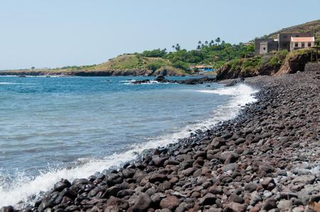 Empty black rock stone beach at the blue ocean of the coast of cape verde island Stock Photo