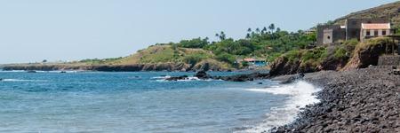 island: Empty black rock stone beach at the blue ocean of the coast of cape verde island Stock Photo