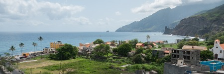 View over small town with houses, people and palm tree at coastline of cape verde island